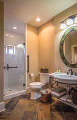 Franklin lodge photo - Beautifully appointed first floor guest suite bathroom with walk in shower.