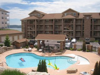 Branson condo photo - Heated swimming pool open April thru Oct, right next to unit, parking and lake.