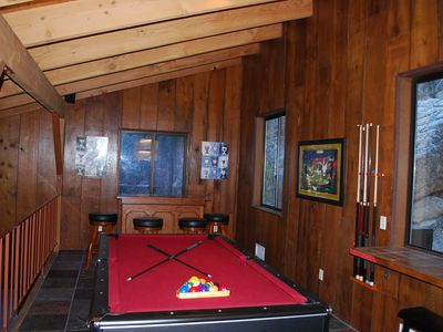 Game Room, pool table, wet bar, gaming table, popcorn machine and more.
