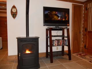 Blue River cabin photo - Pellet Stove and TV with DVD Library