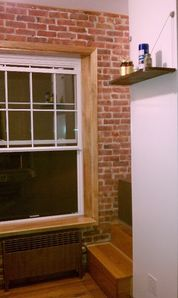 Large Windows. Exposed Brick Wall. Hard Wood Floors. High Ceilings.