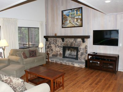 Incline Village house rental - Living area with wood-burning fireplace and upgraded entertainment system