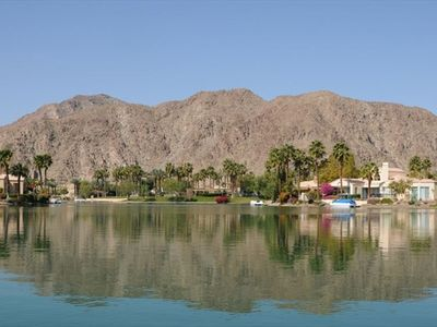 VIEW OF PRIVATE PARK WITH POOL AND TENNIS ON LAKE LA QUINTA