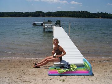 Enjoy the private pier & swim raft ...clean sandy bottom with gradual drop off
