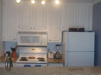 Full size kitchen.  coffeemaker, blender, toaster, waffle maker, dish washer.