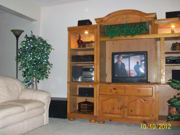 "Living Room with 42"" flat screen TV and home entertainment center"