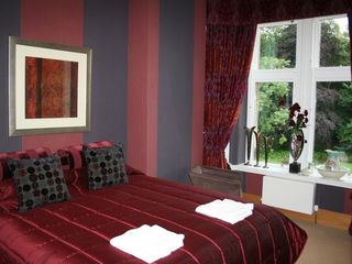 Auchterarder, Gleneagles and The Ochils apartment photo - Red Bedroom as a Superking bed