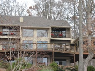 Huddleston house photo - lakeside of house with balconies, decks and screened porch