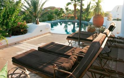 2nd Level Deck - Chaise Lounges, large pool and jacuzzi, spectacular sunsets !!