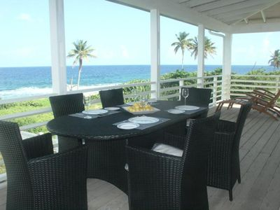 al fresco dining area on upper balcony of your villa, with stunning views!
