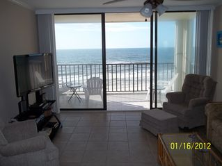 Gulf Shores condo photo - Imagine sitting in the rocking chair, watching tv, and listening to the waves!!