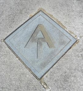 Sidewalk markers confirm you are hiking the Appalachian Trail-just out your door