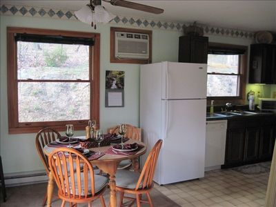 Enjoy homecooked meals & view the wooded area from inside the Knotty Pine.