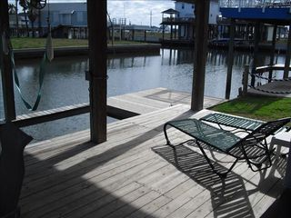 Sea Isle house photo - downstairs deck with tables,seating ,boat slip, with under water fishing