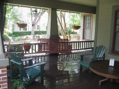 Wrap-around front porch with swing. Mosquito curtains to keep away pesky bugs.
