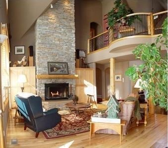 Living room offers stone fireplace and spacious surroundings