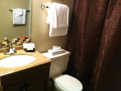 Two renovated bathrooms with new cabinets, granite and tile floors