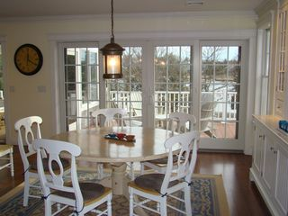 Bourne house photo - Dining area looking out to gated deck and water