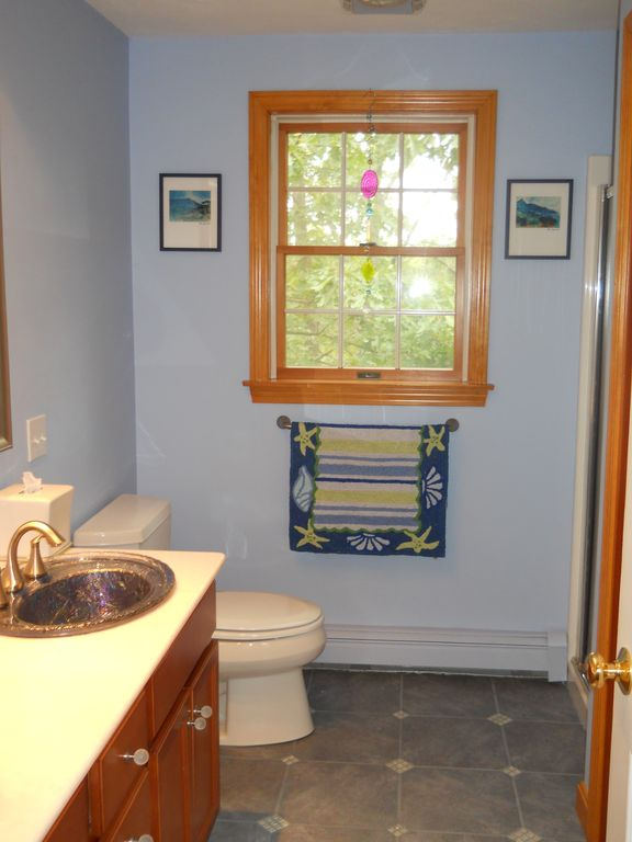 Kitchen level bath - two sinks, shower, and full size washer and dryer