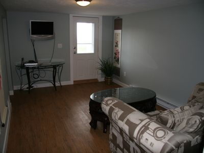 2nd Living room with TV and DVD player and game table.