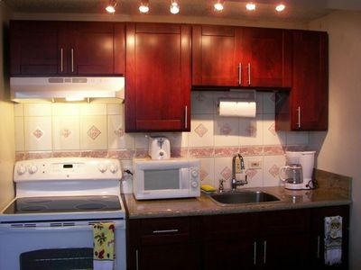 Unit A with full kitchen, full stove and full refrigerator.