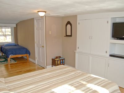Master bedroom has an alcove with single bed