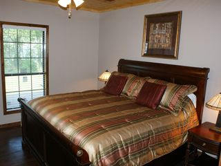 Milam lodge photo - 1st floor Master bedroom has a 26 inch flatscreen TV and view of Lake.