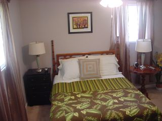 Duluth house photo - Queen bed,digital cable t.v. telephone, fan,closet,alarm clock,and full bathroom