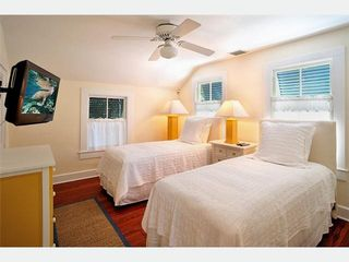 Key West house photo - The Southernmost Bedroom 2 has twin beds that convert to a king, flt screen TV.