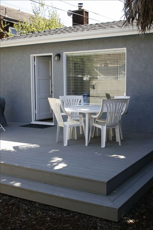 Comfortable backyard deck with outdoor patio table & chairs