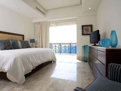 Guest Bedroom with King Bed and Sliding Glass Doors to Oceanview Balcony