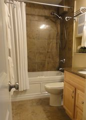 Maalaea condo photo - Spa-like bath: soaking tub, rain shower, granite floors & tub surround.