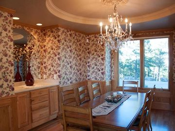 Exquisite formal dining room. All windows have fabulous views of forrested land.