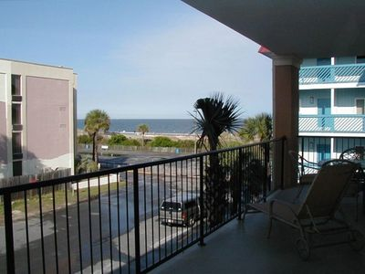 Tybee Island condo rental - Spacious corner covered deck.View the ocean from both the living room bedroom