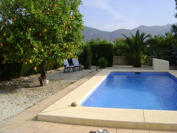 Pool area with view of the mountains behind Jalon