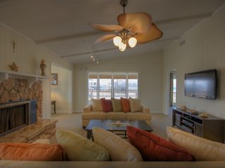 Santa Rosa Beach house photo - Living area with fireplace and flat screen TV