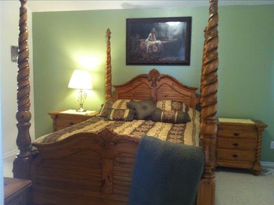 The beautiful master suite with queen bed is ready to take you to dreamland