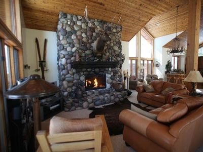 Relax by the fire or watch a movie in the 1400 square feet Great Room