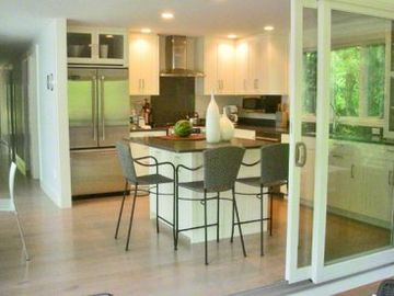 Large Sliding Doors Open The Screened Porch to Kitchen & Inside Dining Area