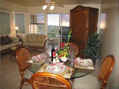 Dining area and living room with Tommy Bahama furnishings.