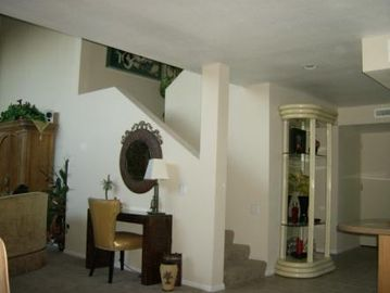 Palm Springs townhome rental - c'mon in ! front door, entry, stair case, living room.....