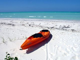 Beach in Front of House with Kayak for Use