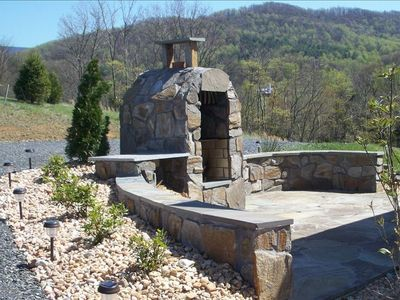 Stone Fireplace and BBQ just off screened porch