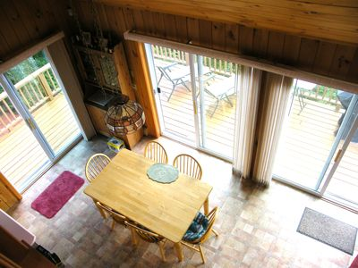 Madison house rental - Looking down from loft - kitchen sliders open to wrap-around deck.