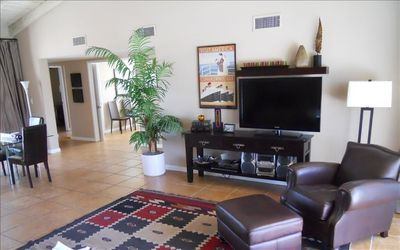 Living-room with 46' HD TV and stereo system; dining area and den also visible