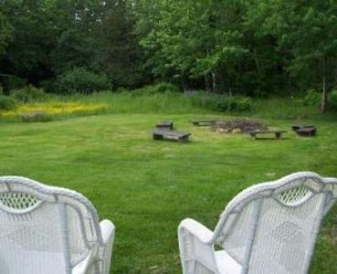 Large Back yard with fire pit, gas grill 2 picnic tables,and tree swing