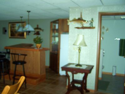 Basement - Wet bar, picture of bathroom on right