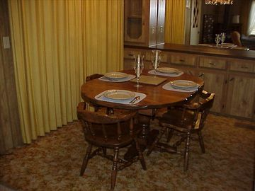 Dining room with plenty of seating for six people.