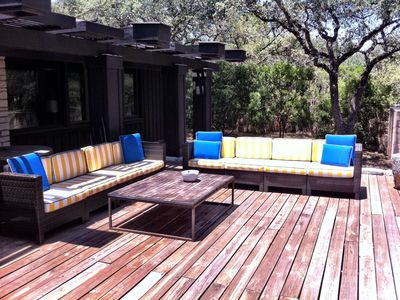 Bright Striped Large Sofas on the Deck overlooking the Lawn and the Lake
