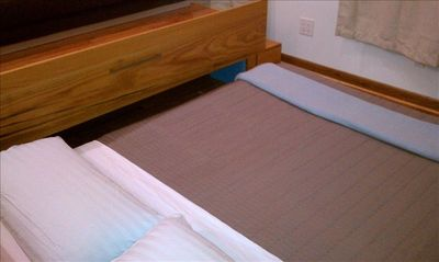 Queens studio rental - Queen Tempur-Pedic Bed is Rolled Out from Inside the Platform.